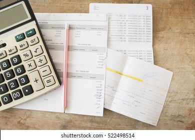 document monthly expense of credit card with passbook bank and payment slip of bank