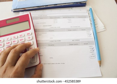 document monthly expenses credit card and hand doing accounts