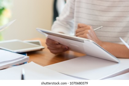 Document office Busy Business Concept: Two Businesswoman working and studying together use pen stylus tablet on documents paper for report and discuss finance and marketing solution in office.