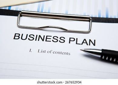 Document with title business plan and office supplies