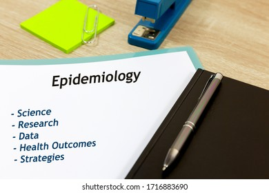 Document with the title Epidemiology alongside items on a desk
