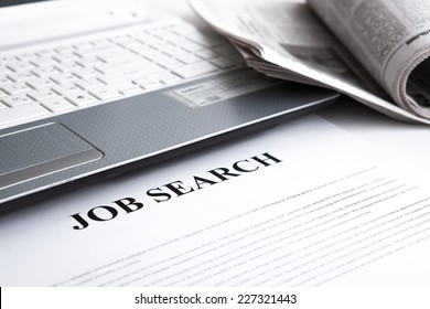 document with the title of job search with newspaper closeup