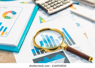 documents with analytics data lying on table,selective focus