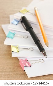 Documents with binder clips on wooden table