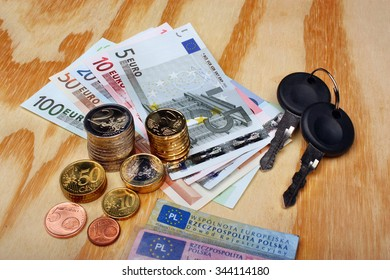 Documents car keys and money euro on the table
