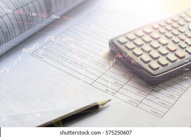 Documents of financial budget stock market investment charts and calculator on the table.