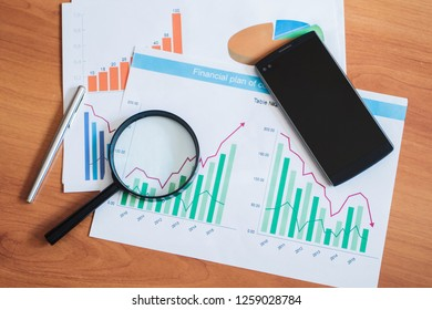 Documents with graphs and diagrams. Information analysis business chart.