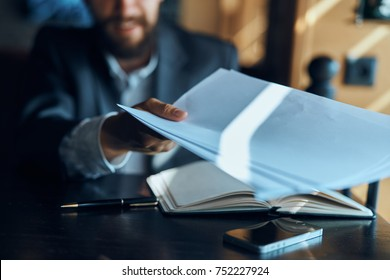 documents in the hand of a business person