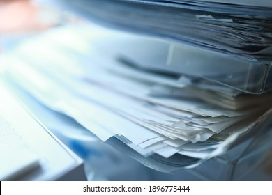 Documents, papers, material, notes, files in a plastic holder, office.
