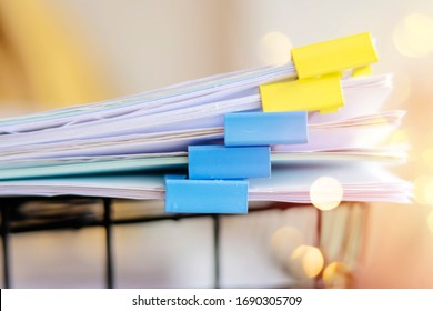 Documents placed in the office on the document basket by using clips to classify important content. The paper clip divides the document into categories.
