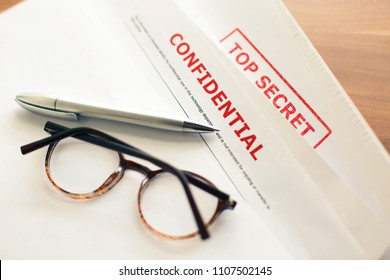 Documents with the stamp of Confidence and Top Secret on the desk. The concept of espionage and industrial safety.