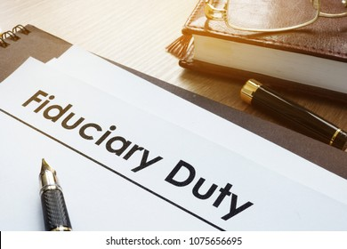 Documents with title fiduciary duty on a desk.