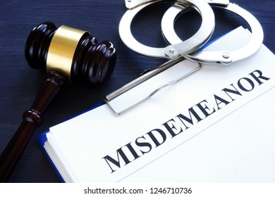 Documents with title misdemeanor and gavel.