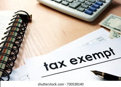 Documents with title tax exempt on an office table.