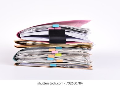 documents,Office Pile of documents with colorful clips on isolated