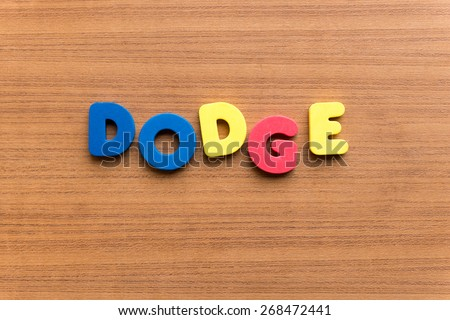 Dodge Colorful Word On Wooden Background Stock Photo Edit Now