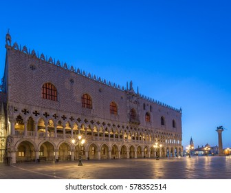 Dodges Palace in Venice at Dawn with blue sky and lights on.