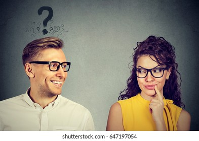 Does she like me? handsome man with question mark looking at an attractive girl flirting with him. Human emotions face expression perception