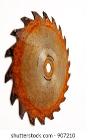 DOF shot of rusty circular saw blade, focus on rotational arrows at the center mount hole, isolated over white background