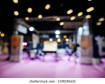 Dofucsed wedding exhibition with silhouettes of people and customers and exhibitions preparing for the marriage event