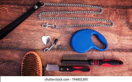 Dog accessories on wooden background. Top view. Pets and animals concept