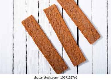 dog biscuits on white wood background