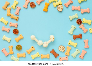 Dog biscuits, dog snack or dog treats in copy space in center on color background, Can use for background, Advertising product food or pet food.