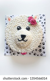 a dog cake made of whipped cream by icing fondant technique