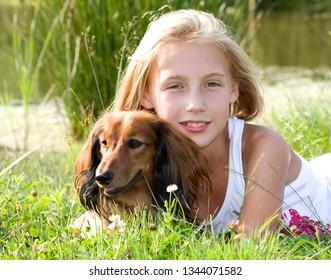 Dog dachshund and girl