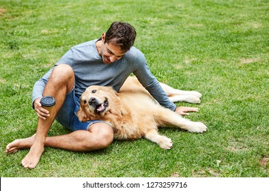 Dog and dude in park, relaxing together