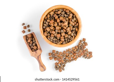 dog food in a bowl and snack like bone on white background, top view, selective focus