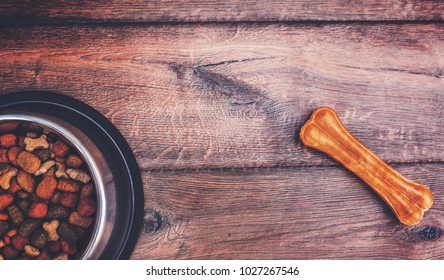 Dog food on wooden background. Top view. Pets and animals concept