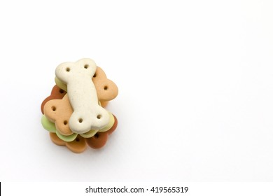 Dog food , Pile of dog biscuits in the shape of a bone for pet food, in square frame shape for background use.