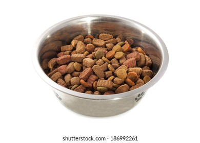 Dog food in silver bowl isolated over white