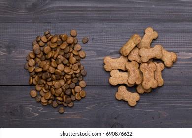 Dog food and dog snack dark wooden background