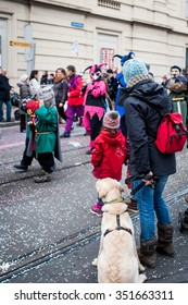 A dog with his family in Swiss carnival