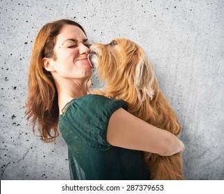 Dog kissing her owner