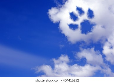 dog paw trail in the sky clouds