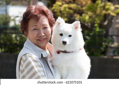 Dog pet and senior woman