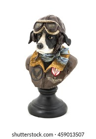 Dog in pilot costume sculpture for decoration isolated on white background