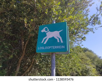Dog sign in a park