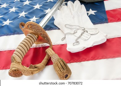dog tags on military gloves by sword