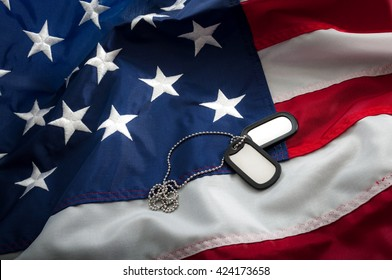 Dog tags are used for the identification of dead and wounded soldiers; they have personal info about the soldier and convey basic medical info, like blood type and history of inoculations on USA flag
