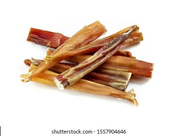 Dog treats. A group of natural dog teeth cleaning bully sticks on white background