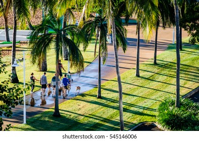 Dog walkers on The Strand, Townsville, Queensland, Australia