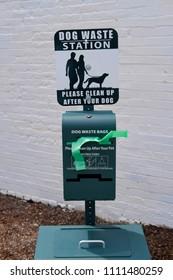 Dog waste bag dispenser in city