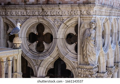 Doge's Palace in Venice, details of the decorations and bird sitting on the terrace. The Doge's Palace is one of the symbols of the city of Venice. Beautiful sculptural details and seagull.
