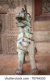 Dog-lion statue decorated with stones. Wat Ho Phra Keo (Altar of the Emerald Buddha), Vientiane, Laos