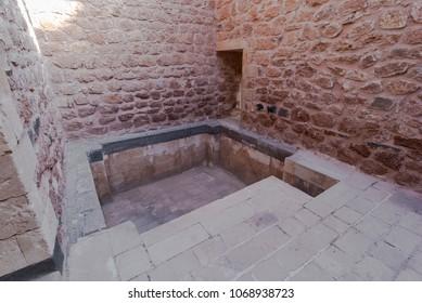 DOGUBAYAZIT - NOVEMBER 29: Old stone bath in Ishak Pasha Palace on November 26, 2016 in Dogubayazit, Agri province, Turkey.
