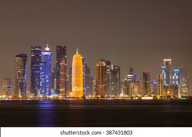 Doha city skyline illuminated at night. Qatar, Middle East